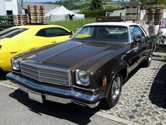 My Mom had one of these, it was Orange with white leather interior. 1974 Chevrolet Malibu Classic coupe with Swivel Bucket seats