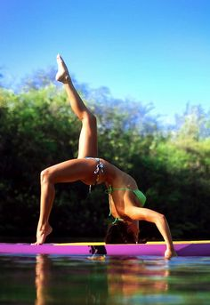 SUP yoga! holy cow! That is some balance!