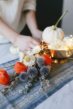 Click thru to learn how I used dried flowers, mini twinkly lights, and white pumpkins for a super simple, eye-catching centerpiece for fall or Thanksgiving entertaining. Get the full DIY tutorial on J White Pumpkin Centerpieces, Wedding Centerpieces, Pumpkin Picking, Do It Yourself Crafts, White Pumpkins, Dried Flowers, Autumn Flowers, Diy Craft Projects, Craft Ideas