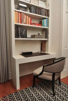 Built-in flows with the rest of the room. This would be amazing in a bedroom. Love the storage and rug and chair.
