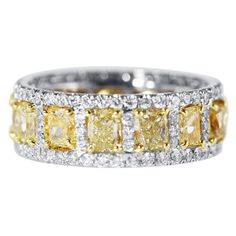 Fancy Yellow and Near Colorless Diamond Gold Platinum Band Ring | From a unique collection of vintage band rings at https://www.1stdibs.com/jewelry/rings/band-rings/