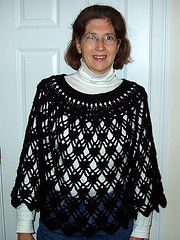 The same poncho as the turquoise one - just in black. Free pattern download from Ravelry