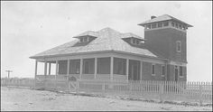Little Kinnakeet Coast Guard Station, 1935.         Little Kinnakeet was staffed by a keeper and six surfman. It was not until the early 1900s that the station was occupied year round. The original station was converted to a boathouse in 1904 when a larger station was completed.     The site remained active under the U.S. Coast Guard until 1954, when it was decommissioned and transferred to the National Park Service as part of Cape Hatteras National Seashore.