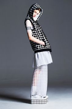 Piece d'Anarchive Black & white checked hoodie with short white skirt & long white mesh skirt. #ss14