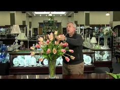 Beautiful floral arrangement tips. Use clear tape and build from the outside in. Very helpful.