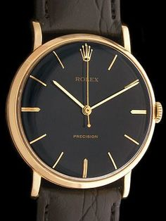 1964 Black/Gold Vintage Rolex Precision - Classic Rolex Dress Watch with Solid Gold Case and High Grade Rolex Manual Wind Movement. Signed Rolex on the Dial, Case, Crown and Movement. - Swiss Made, 18 Jewel Rolex Manual Wind Caliber 1210 Movement Adjusted to 5 Positions and Temperature. Movement Signed Inside Montres Rolex S.A., Geneva, Switzerland. Ready to Wear.