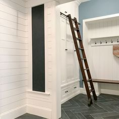 Artisan home tour mudroom with white shiplap, herringbone tile floor, built-in chalkboard, storage cubbies, rolling ladder