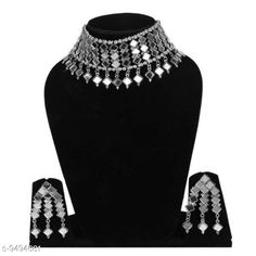 Checkout this latest Jewellery Set Product Name: *Mirror Jewellery Set* Plating: Oxidised Silver Country of Origin: India Easy Returns Available In Case Of Any Issue   Catalog Rating: ★4.1 (213)  Catalog Name: Diva Fusion Jewellery Sets CatalogID_1671226 C77-SC1093 Code: 242-9494681-006