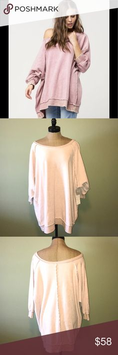 "Free People my pullover Slouchy top medium Free People ""my pullover"" slouchy top. New with tags. Size medium. Oversized fit. This would fit up to an XL depending on how loose you want it. The color listed on the tag is ""grey"" but as the photos show it is a light pink in color. The other photos are just to show the fit of the item. 60% cotton 40% polyester. Free People Sweaters Crew & Scoop Necks"