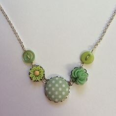 Florence necklace with green polkadots and florals.  Vintage inspired necklace, created using a combination of fabric, buttons and flower resins in silver settings on a silver plated chain with extension chain.  The Florence necklace is available in a variety of colours and with a selection of matching and coordinating earrings, please see my other shop listings.