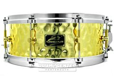 Canopus 'The Brass' Hammered Snare Drum 14x5.5 w/ Cast Hoops  The deep, rich sound of brass with increased overtones from our hammering process make this a unique and powerful sounding drum. The vintage snare wires add a complex characteristics to the tone of this dynamic snare drum. Purchase Here:  http://www.drumcenternh.com/drums/snare-drums/canopus-the-brass-hammered-snare-drum-14x5-5-w-cast-hoops.html