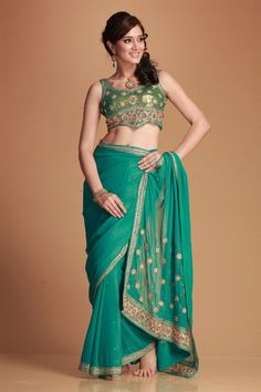 Shabana- Revti Palmer festival collection designer saree, soft georgette with heavy hand embroidery of zircon, sequence and beads on borders, pallu and. Handwork butis on allover embroidered saree. Closet (stitched blouse) with heavy hand embroidery