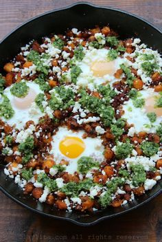Chorizo and ripe plantain hash with eggs, queso fresco, and spicy cilantro sauce