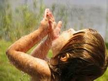 I hope that I never get too old to stand in a warm soaking rain and catch raindrops on my tongue.