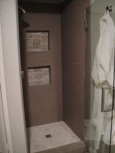 Shower Stall With All Tiles And Stones Used Throughout The Master Bathroom  Design.