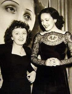 """Linda Darnell meeting Edith Piaf [French cabaret singer who became national symbol during WWII. Piaf was nicknamed """"the sparrow,"""" an appellation that escapes me since her voice is quite gutsy IMO. Something lost in translation perhaps.]"""