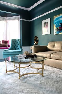 Shades of jade look luxe with touches of gold accompanied by the faux sheepskin rug. Love.