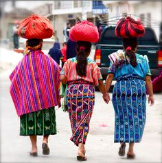 Walk hand-in-hand like these women in Guatemala.  We are strong enough to carry any burden, so stand straight and tall! #ridecolorfully