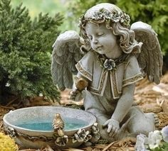 Garden angel - I want one for my flowers.