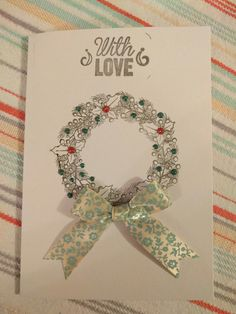 Stamped wreath Christmas card with liquid pearls and bow embellishments