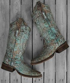 Be a stylishly dressed cowgirl by completing your outfit wearing these uniquely-designed women's boots. Handcrafted in taupe distressed leather, these boots stand out in gorgeous flair with butterfly