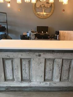 Wondering what to do with an old door you can pick up at a thrift store or flea market? turn it into a unique kitchen island! watch the before and after transformation of this repurposed upcycled door. Furniture Boutique, Boutique Decor, Boutique Interior, Boutique Design, Boutique Clothing, Furniture Stores, Bridal Boutique, Retail Counter, Store Counter