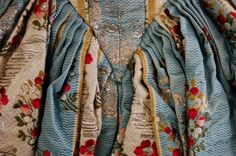 Detail back view, robe à l'Anglaise, 1770s. Silk woven in robin's-egg blue cannele silk with silver thread blooms and silk rose sprigs, silver thread undulations within the ivory stripes.