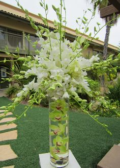 http://floristinsandiego.com/events/2011/10/26/white-orchids-white-hydrangea-atop-a-cylinder-of-submerged-green-cymbidium-orchids/