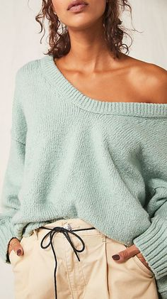 So cool and effortless, this slouchy, oversized tunic-style sweater features a scoop neckline and dropped dolman sleeves for added shape. SEveral colors available.