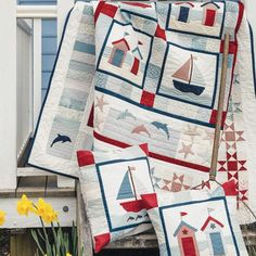 Appliqué and patchwork seaside quilt and cushions styled shot Colchas Quilting, Quilting Designs, Quilting Ideas, Hanging Quilts, Quilted Wall Hangings, Beach Themed Quilts, Coastal Quilts, Nautical Quilt, Beach Quilt