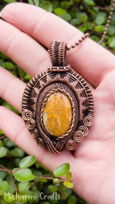 Wire Wrapped Fossil Coral Pendant Yellow Fossil Coral with beautiful sunflower pattern, wrapped in an intricate wrap of copper wire. Wire Pendant, Wire Wrapped Pendant, Wire Wrapped Jewelry, Copper Jewelry, Gemstone Jewelry, Copper Wire, Wire Jewelry Designs, Handmade Jewelry, Bijoux Fil Aluminium