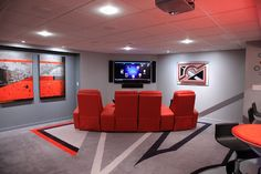 """Ultimate Basement Game Room - """"This viewing area features a 60-inch Sony TV, flanked by Definitive Technology Mythos speakers."""" Main Story: http://www.electronichouse.com/article/ultimate_basement_game_room_includes_simulated_shooting_range"""