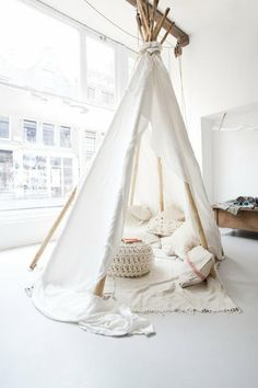 This would be great for the bonus room, adult sized teepee, for kids and adults. Maybe add some bunting and light, but nothing that clashes with rug...
