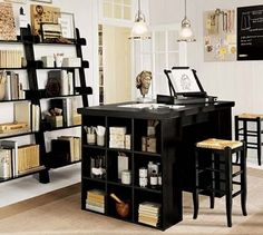 im doing this to our office. having the waist high desk/craft table in the middle of the room is something i never thought of.