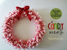 this festive holiday wreath is easier than it looks - all you need is a big bag of candy, some floral tape, and a wire hanger.