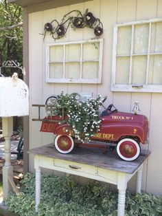 what to do with a vintage Toy car....(answer= USE as a PLANTER in your garden) ....cute idea