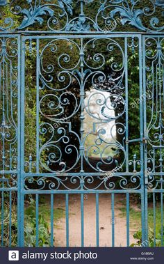 Walled garden blue wrought iron gate at Rousham House and Garden Stock Photo, Royalty Free Image: 104057902 - Alamy