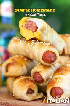 A hot dog baked right inside a soft beer pretzel makes these the tastiest and easiest homemade pretzel dogs you will ever eat! Ready in just 35 minutes you can enjoy these any night. They are a great make ahead recipe and they freeze well too. Just thaw and pop them in a 350°F oven until warm, about 5-8 minutes.