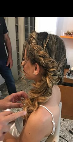 Bride hairstyle front row braid crown side pony tail wedding hair