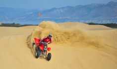 Four Wheeling | Not far from the beautiful rolling green hills of San Luis Obispo, CA are the golden Oceano dunes. Rent an off-road vehicle and kick up some sand.