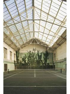"""private, indoor tennis court with a ceiling of light. rather like in the film """"Sabrina"""""""