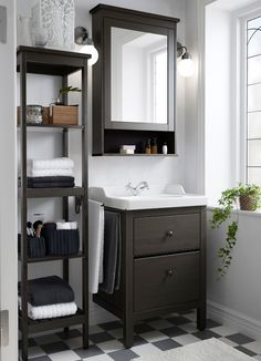 A small traditional bathroom with HEMNES washstand, shelf and mirror cabinet in brown.