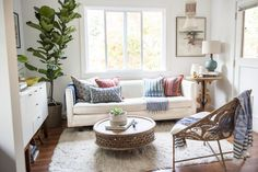 """""""For the living room, I really wanted it to be neutral in terms of the larger furniture items so that I could have fun with colorful fabrics and lighting pieces,"""" says Ashley. """"I loved the vintage beaded ceiling fixture because it feels very '70s, which goes so well with the fireplace."""""""