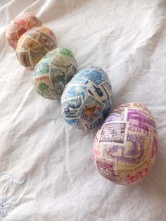 This is what I can do with some of Grandpa's stamp collection!  These are decoupaged onto wooden eggs.