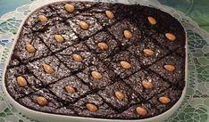 Πεντανόστιμο ραβανί σιροπιαστό με σοκολάτα και ινδοκάρυδο. Μια παραλλαγή ενός αγαπημένου σιροπιαστού γλυκού, του κλασικού ραβανί που θα απογειώσει τη γεύση
