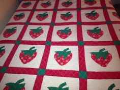This strawberry quilt was made by my Granny Cantrell.