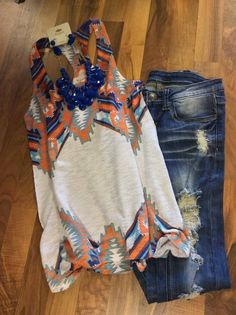 Love the design on the shirt. It's perfect with the distressed denim. Just needs a really cute pair of sandals or peep toe booties.