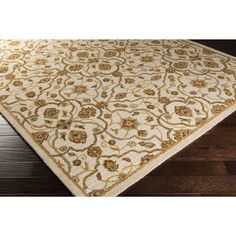 Bring luxury to your home with this floral designed area rug. Hand-tufted with wool, this rug will definitely add a pop of color and the finishing touch to your décor.