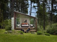 Sandie Pope and Gordon Walker relax just outside their bedroom on the meadow side of their Orcas Island property.