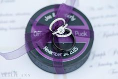 Bride & groom's wedding rings attached to a purple and black hockey puck | Leslie Ann Photography | villasiena.cc